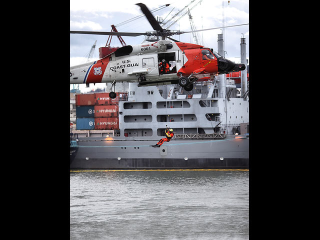 The Coast Guard providing a demonstration of their helicopter rescue operations during the tour of their facility on Swan Island. Photo courtesy of Steven Fritz.