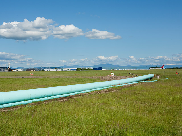 Installation of the pipe was planned around existing airport features like the crosswind runway.  Horizontal directional drilling was used to install the pipe.  Pulling the pipe underground and into place took nearly 24 hours.