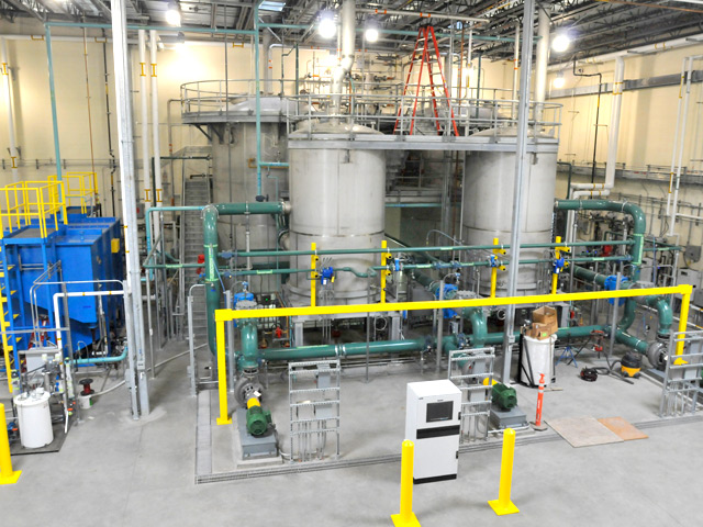 An interior view of the treatment plant looking toward the separators and reactors, which are part of the anaerobic system that breaks down the biodegradable deicing fluids.