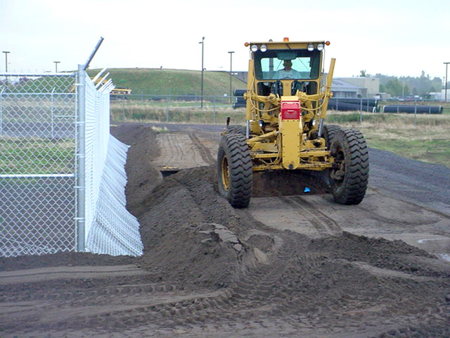 Exclusion fencing deters coyotes from digging underneath the airfield fence.