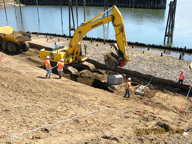 Wheeler Bay: Contractor placing concrete blocks to anchor large woody pieces to provide habitat on lower elevations of slope.