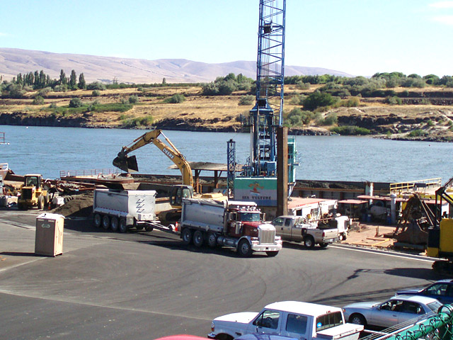 Dredging: Offloading of dredged material from the barge into trucks for disposal at a landfill at The Dalles, Ore.